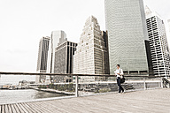 USA, New York, Businesswoman walking in Manhattan - UUF09186