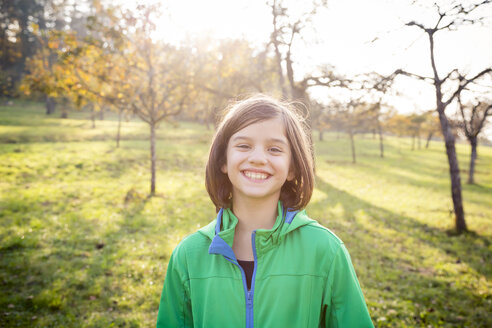 Portrait of smiling girl on a meadow in autumn - LVF05597