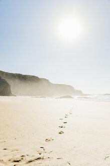 Portugal, Alentejo, Rocks and footprints at Zambujeira do Mar beach - CHPF00335
