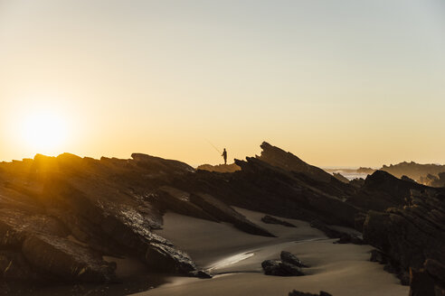 Portugal, Alentejo, Sunset at Zambujeira do Mar beach - CHPF00338