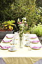 Laid table in garden, decorated for a birthday party - MFRF00726