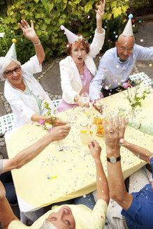 Group of seniors celebrating, drinking champagne - MFRF00783