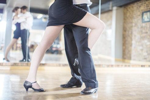 Close-up of couple dancing salsa in studio - ZEF11732