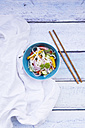 Bowl of glass noodle salad with vegetables, cloth and chopsticks on wood - LVF05612