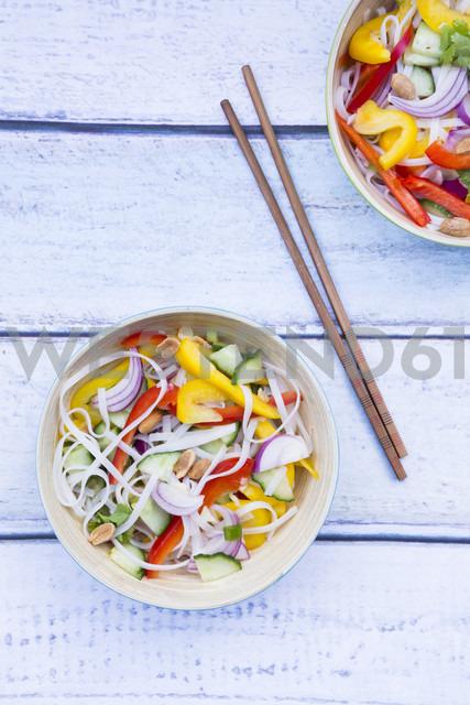 Bowls of glass noodle salad with vegetables on wood - LVF05615