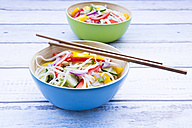 Bowls of glass noodle salad with vegetables on wood - LVF05618