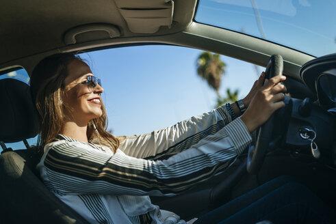 Smiling woman driving car - KIJF00904