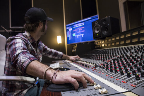 Man working in the control room of a recording studio - ABZF01546