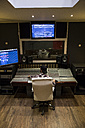 Man working in the control room of a recording studio - ABZF01552