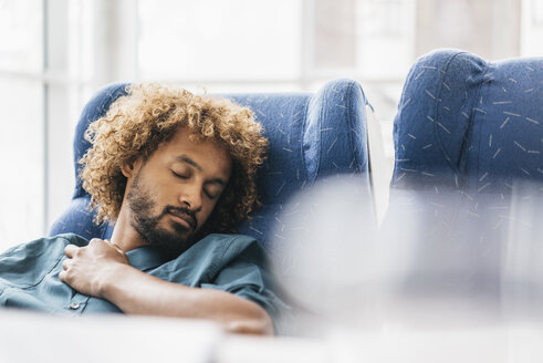 Young man sleeping in arm chair - JOSF00459