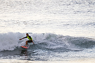 Boy surfing in the sea - SIPF01107