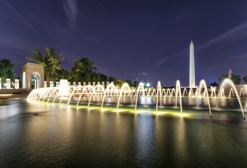 USA, Washington DC, National Mall, World War II Memorial with Washington Monument in the background - SMAF00597