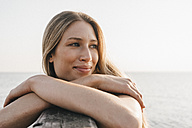 Portrait of happy young woman at the sea - KNSF00682