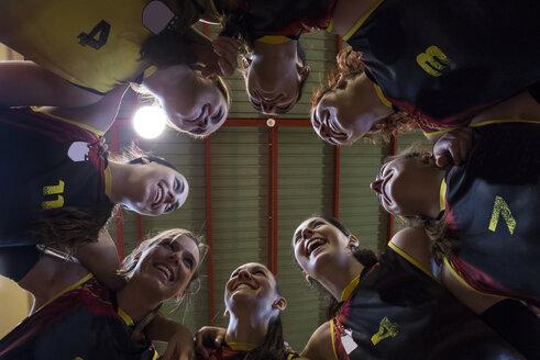 Happy female volleyball team huddling - ABZF01568