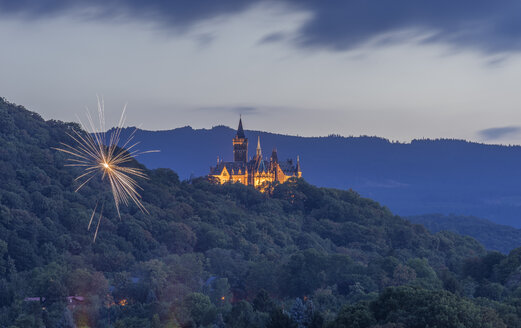 Germany, Wernigerode, view to fireworks and illuminated castle in the evening - PVC00942