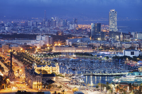 Spain, Barcelona, view to the lighted city at night - ABOF00123