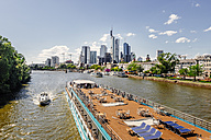 Germany, Frankfurt, view to skyline  with tour boat on Main River in the foreground - KRPF02031