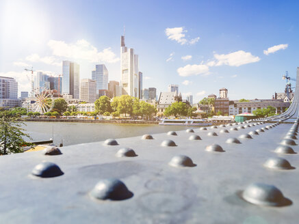 Germany, Frankfurt, view to skyline at backlight with girder of Eiserner Steg in the foreground - KRPF02034