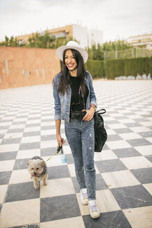 Young woman going walkies with her dog - JASF01308