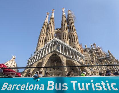 Spain, Barcelona, Tourists in bus at Sagrada Familia Church - EJW00811