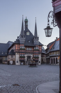 Germany, Wernigerode, view to town hall at market square in the evening - PVCF00949