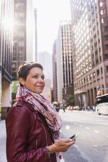 USA, New York City, smiling woman in Manhattan - UUF09406