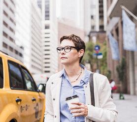 USA, New York City, confident businesswoman in Manhattan - UUF09409