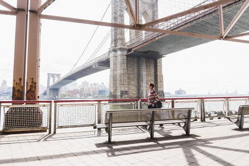 USA, New York City, woman walking at East River - UUF09424