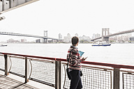 USA, New York City, woman at East River - UUF09427