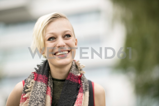 Portrait of smiling blonde woman with scarf - TAMF00851