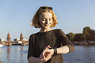 Young woman checking her smart watch - TAMF00860