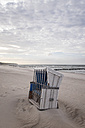 Germany, Warnemuende, locked beach chair on beach - MELF00169