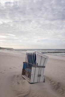 Germany, Warnemuende, locked beach chair on beach - MELF00169