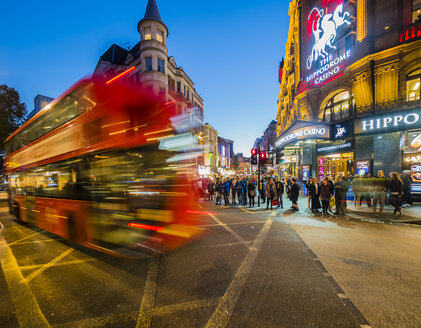 UK, London, St James's, driving double-decker bus at Leicester Square in the evening - AM05092
