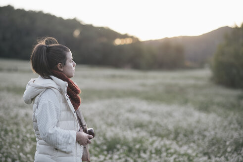 Pensive woman with camera in nature - SKCF00219
