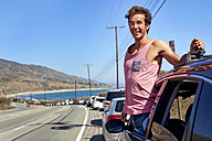 Happy young man on a road trip in summer - WESTF21976