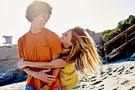 Playful couple on the beach - WESTF22027