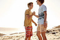 Two happy young man on the beach - WESTF22042