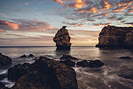 Portugal, Algarve, Albufeira, rock formation at sunset - CHPF00348