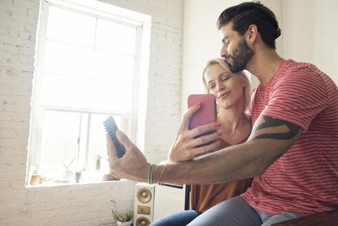 Happy young couple taking a selfie - WESTF22128