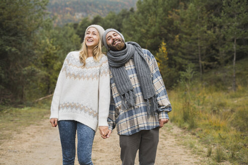 Happy young couple outdoors in autumn - KKAF00083