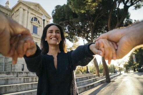 Spain, Barcelona, portrait of happy woman holding hands with her husband - KKAF00131
