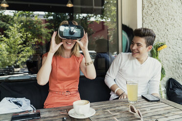 Teenage boy and woman wearing VR glasses - TAMF00886