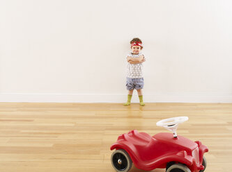 Little girl playing with pedal car - FSF00622