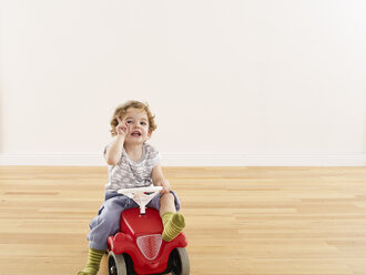 Little girl playing with pedal car - FSF00628