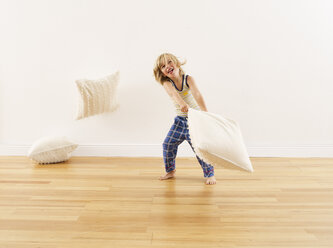 Little boy having pillow fight with himself - FSF00637