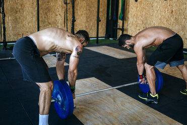 Two athletes preparing barbell in gym - KIJF00961