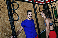 Happy man and woman in gym - KIJF00982