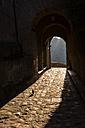 Italy, Lazio, archway at Civita di Bagnoregio by sunset - LOMF00446