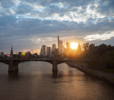 Germany, Frankfurt, view to financial district at sunset with Ignatz-Bubis-Bridge in the foreground - KRPF02058